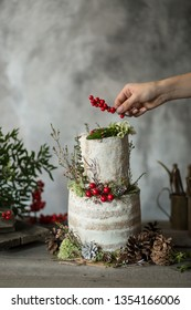 Wedding rustic cake with cream cheese and green leaves decor.