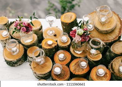 Wedding rustic decoration with logs and stumps and candles