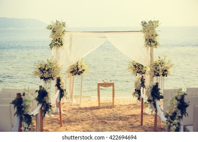 Wedding set up on the beach (vintage color toned image)