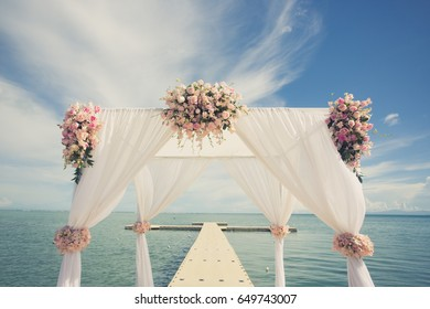 Wedding set up on the beach (vintage colour picture style)