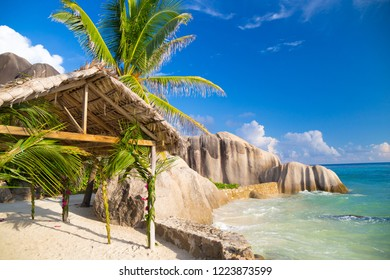 Wedding shelter near tropical beach Anse Source d'Argent with granite boulders on La Digue Island, Seychelles