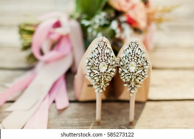 wedding shoes and bouquet with ribbons