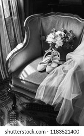 wedding shoes, bouquet and veil on the chair