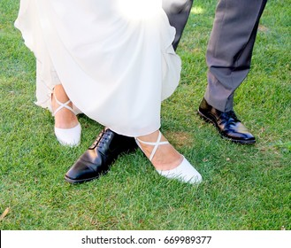 Wedding shoes of a couple