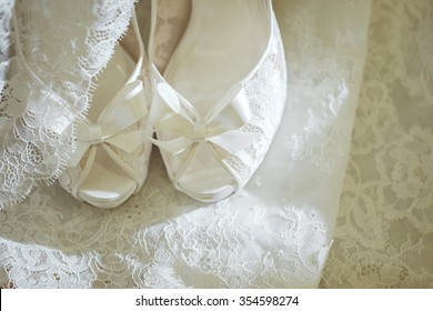 Wedding shoes on wedding dress background