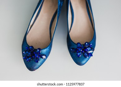 Wedding shoes on their wedding isolated in a room