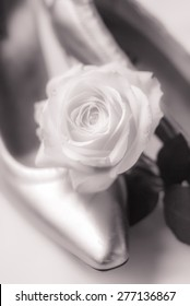 wedding shoes and white rose, close-up and soft focus