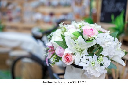 The wedding is a simple, retro style with old bikes and colorful bouquets for a sweet and unique look.