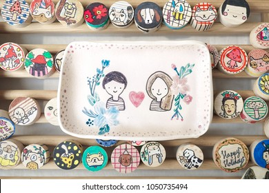 Wedding souvenir or Valentine's gift made from ceramic. Ceramic saucer or dish. Love and romantic concept.