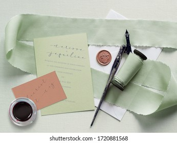 Wedding stationary mock up for a lesbian couple. Pale mint green and blush color palette. Letterpress and calligraphy. Silk ribbon and wax seal details.