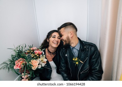 Wedding in the style of rock. Rocker or Biker wedding. Guys with stylish leather jackets. It's a rock'n'roll baby. The sweet couple are photographed in a photobooth.