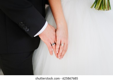 Wedding in the style rustic. The bride and groom in summer outdoor. Bride and groom holding hands.