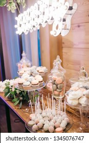Wedding. Sweets, candies, snacks, cakes are on wooden the table