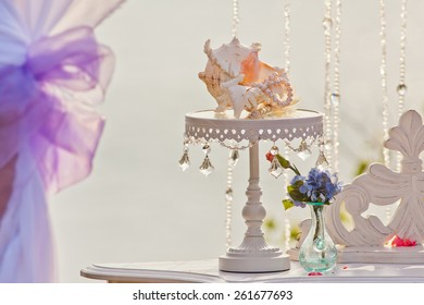 Wedding table with beautiful shell at blue sea background
