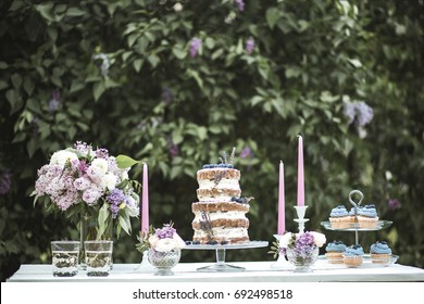Wedding table with blueberry cake