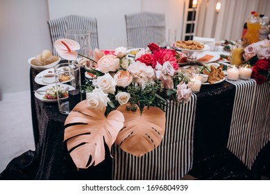 wedding table for the bride and groom with decor and flowers
