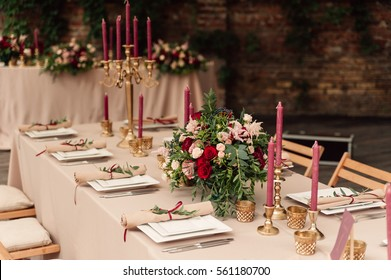 Wedding table decor with red flowers and plates
