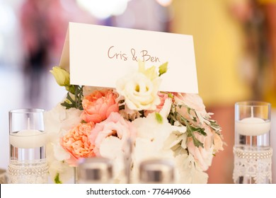 Wedding table decoration with flower, candle lights and place cards