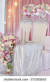 Wedding table decoration with flowers and eclectic chandeliers