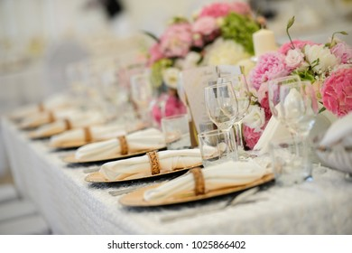 Wedding Table Decoration. Table set for a wedding dinner. Beautiful flowers on table. close up