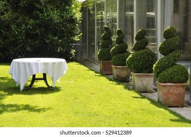 Wedding table at the garden before preparing weddings