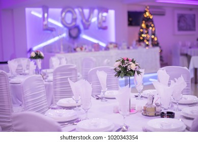 Wedding table with love sign and lights