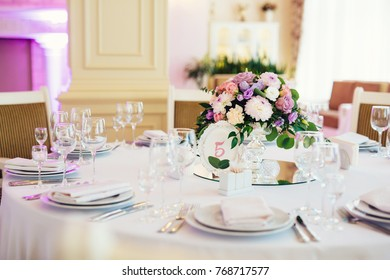 Wedding table served and decorated with flowers