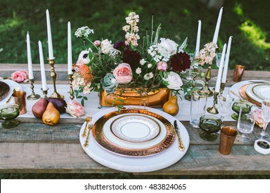 Wedding Table Setting With Floral Arrangement