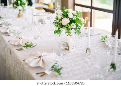 wedding table setting. fresh flowers and dishes on the table.