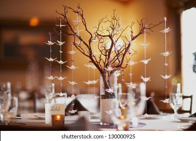 Wedding table setting with nature theme of bonsai tree and origami birds