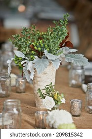Wedding table setting with nature theme of rustic wildflowers