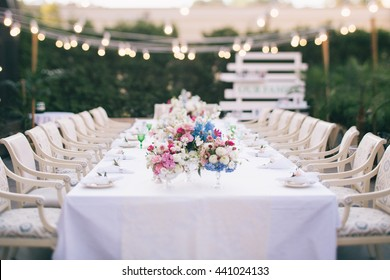 Wedding table that decorated with flower arrangements and candles