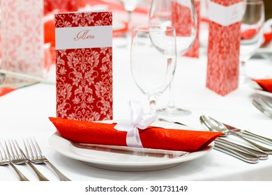 wedding tables set for fine dining or another catered event, red decoration