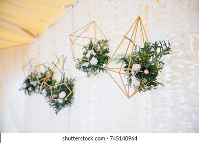 Wedding in a tent. Decoration of the hall. Green tablecloths, beautiful decor and dishes.