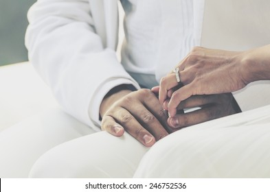 wedding theme, holding hands with love mood and tone.