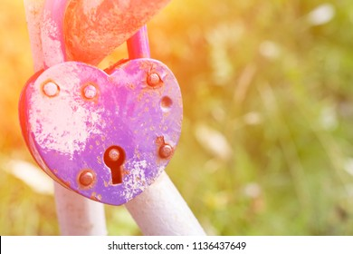 Wedding traditions, big and strong love concept. Blue love lock in the bridge close up