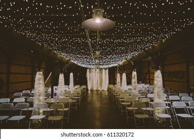 Wedding Venue Barn Industrial Ceremony Room With Lights and Linens