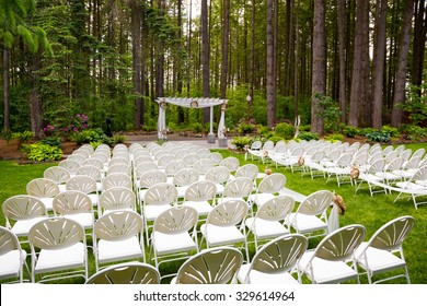 Wedding venue in Oregon has natural trees and beautiful guest seating a midst tall trees.