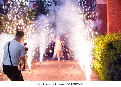 Wedding Videographer Camera Operator is Shooting Bridal Event in the Fireworks
