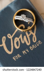 wedding vow book with wedding engagement ring