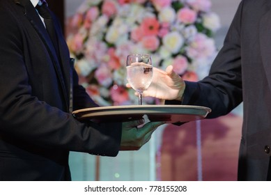 Wedding. Waiter serving champagne on a tray