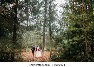 Wedding walking in the forest