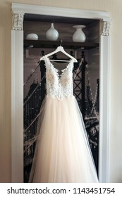 Wedding, white bride dress hanging on the hanger