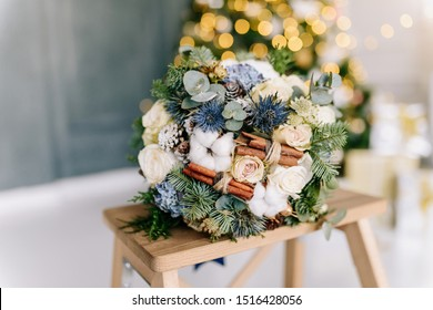 Wedding winter bouquet of the bride. Bouquet of spruce, cones, cotton, cinnamon sticks. Wedding accessories. Floristry