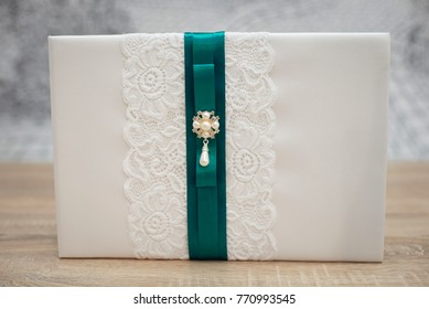 Wedding wish book decorated with flowers and pink lace.