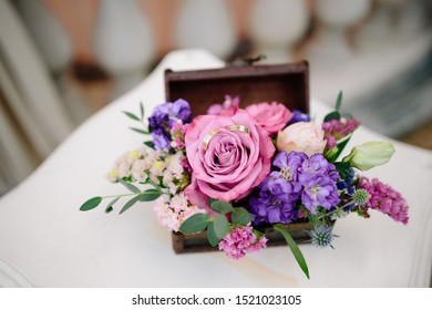 Wedding wooden casket for with wedding golden wedding rings, wedding decor, close up rings, casket filled with flouwers