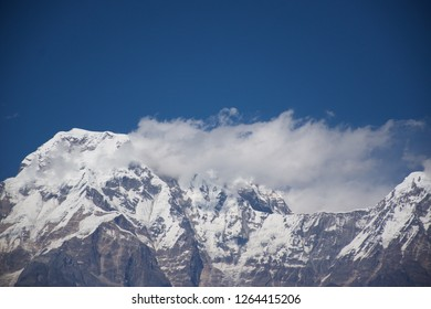 Wednesday, 16 of November of 2016, cloudy mountains, clear sky, and white snow in Katmandu Nepal