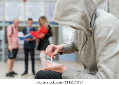 Weed addict smoking a joint inside his highschool in front of other students