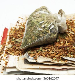 Weed and Cash Dollar Bills, Drug Money from the World Wide Marijuana and Cannabis Market