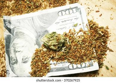 weed and money, marijuana bud and hundred dollar bill